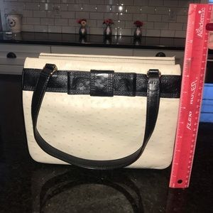 Kate Spade purse.  Cream with black handles/bow.
